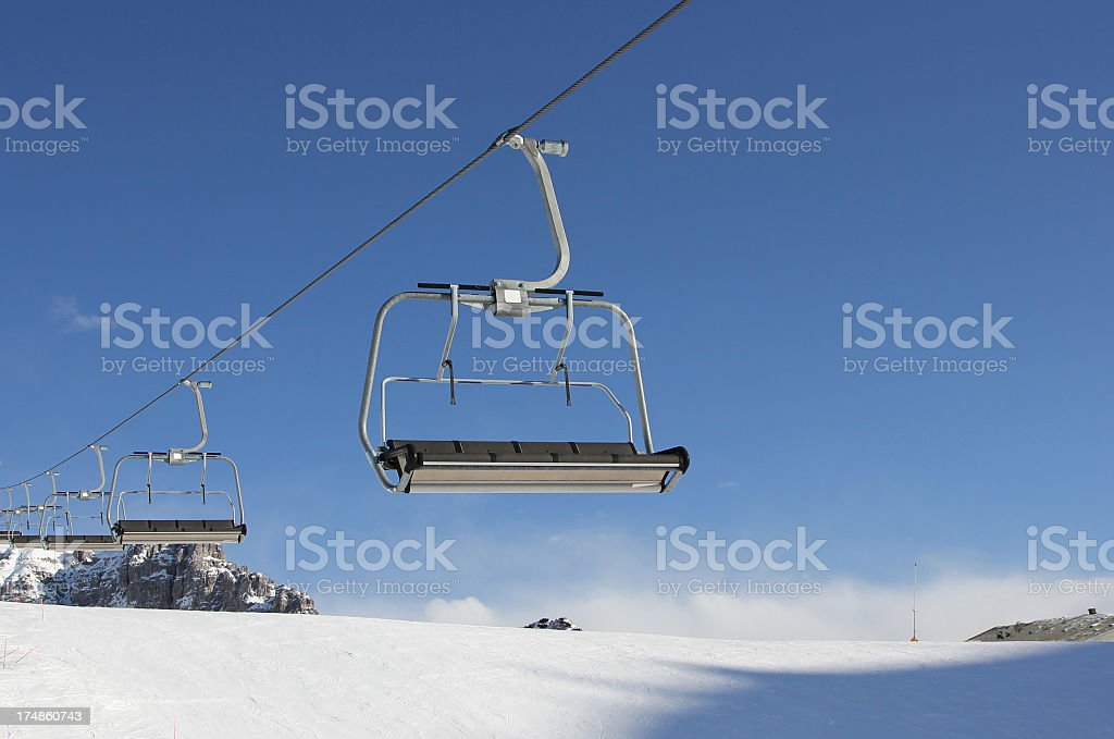 Chair lift isolated on blue royalty-free stock photo