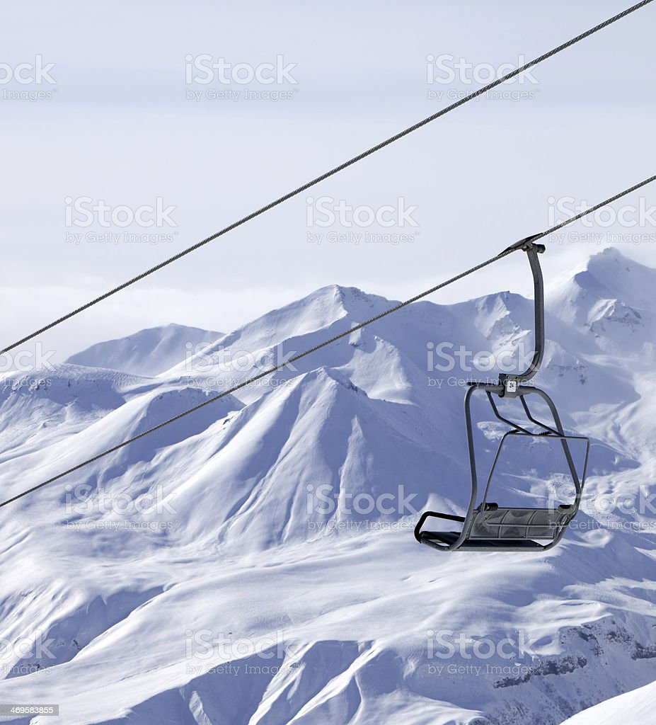 Chair lifts and off piste slope in fog royalty-free stock photo