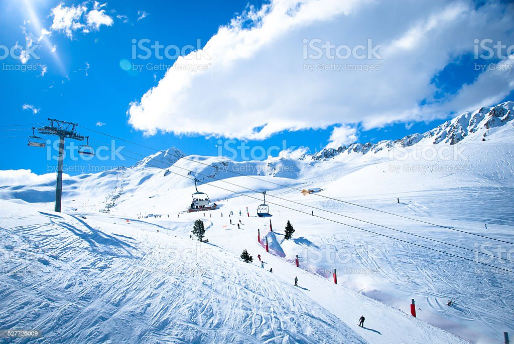 Chair lifts with lens flare - French Alps stock photo