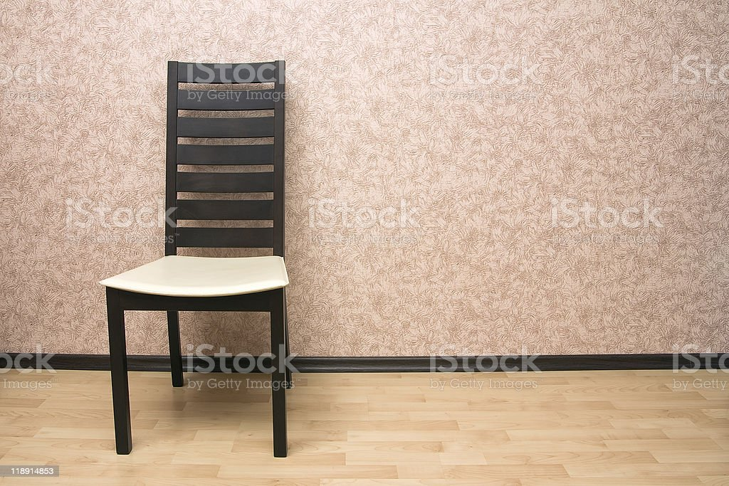 Chair near the wall royalty-free stock photo