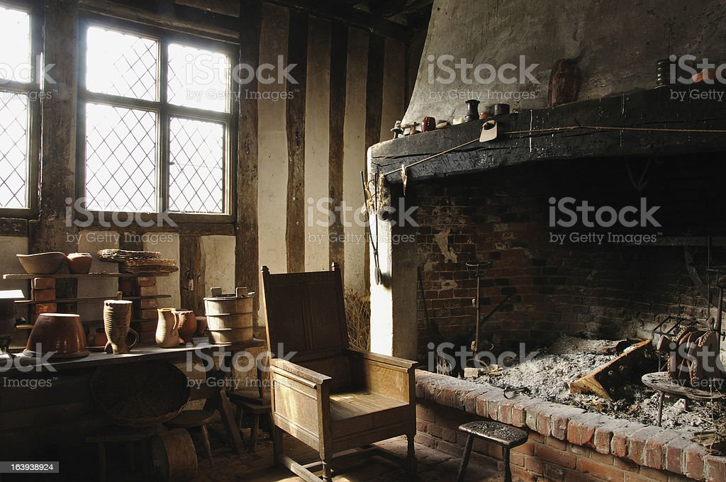 Chair next to fireplace in medieval bakehouse royalty-free stock photo