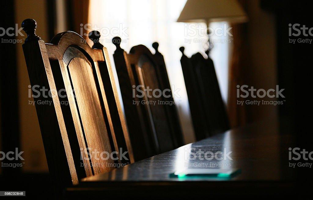 Chair of the room of the dim light foto de stock libre de derechos