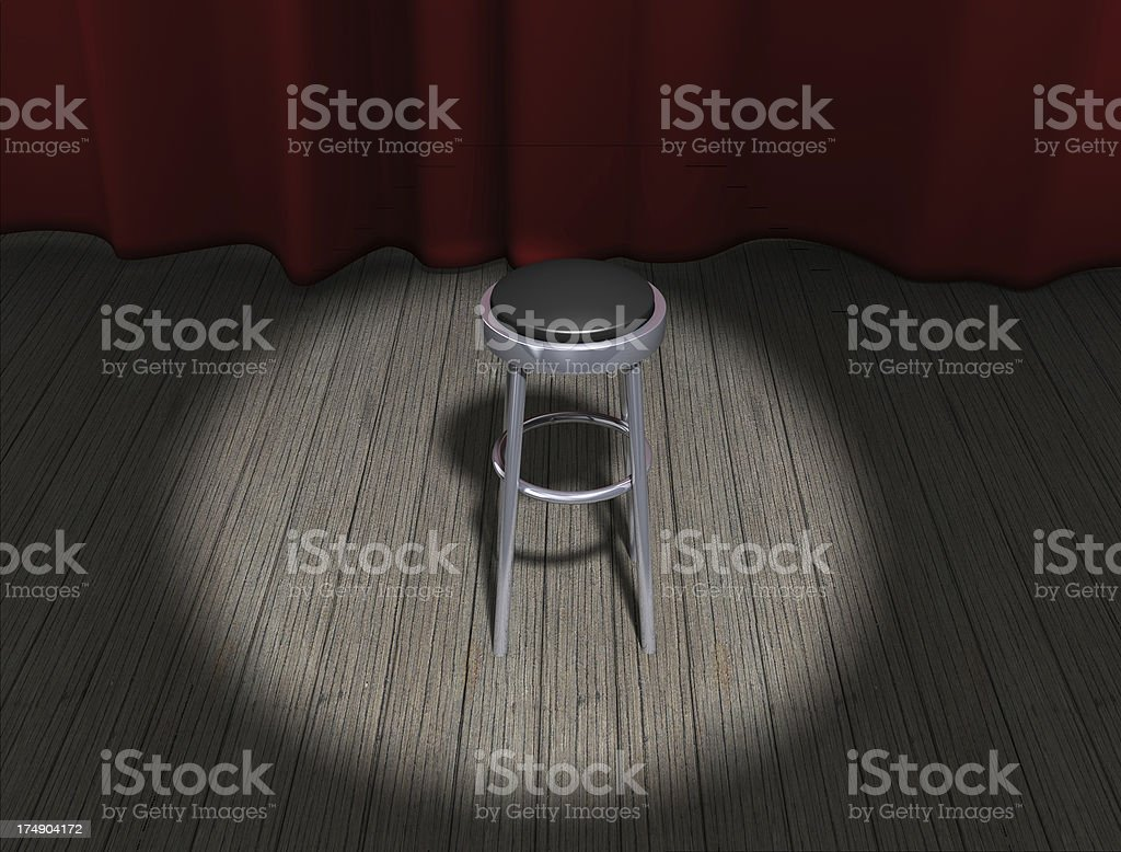 Chair on stage with spotlight royalty-free stock photo