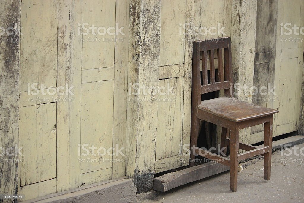 Chair on the wall royalty-free stock photo
