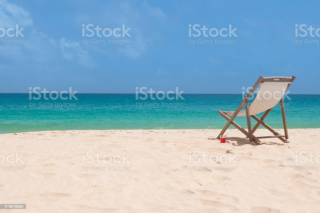 chair on white sand stock photo