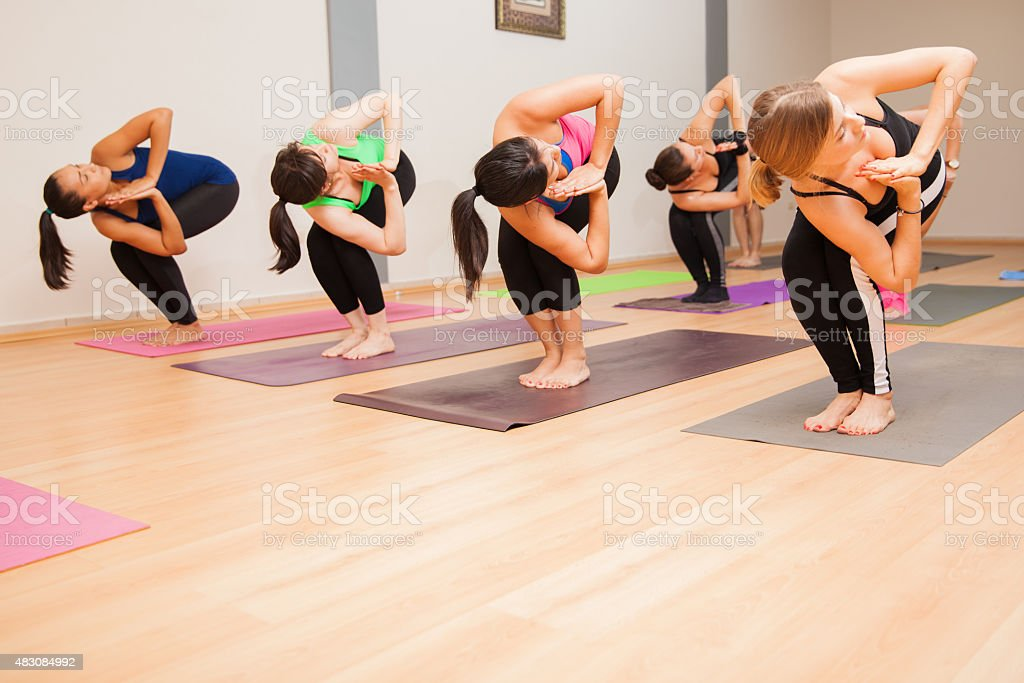 Chair twist pose in a yoga class stock photo