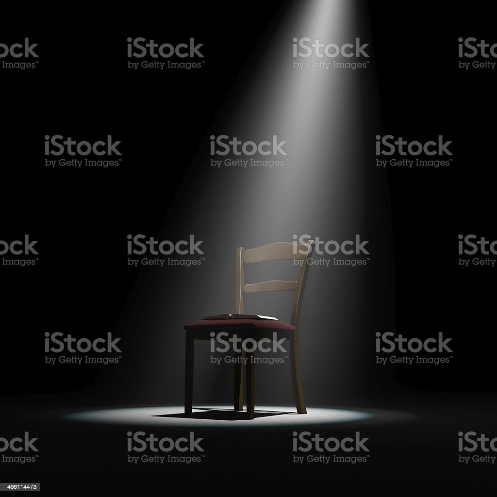 Chair with book on stage (before author reading event) stock photo