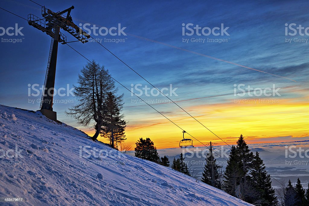 Chairlift at dusk stock photo