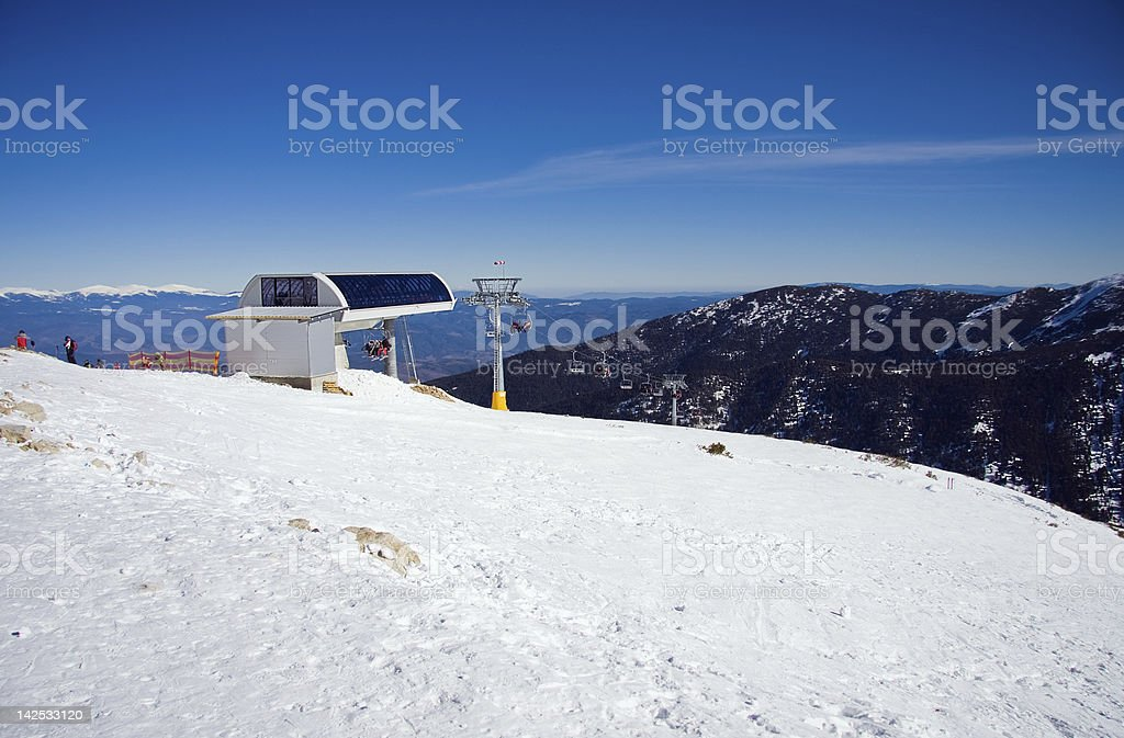 Chairlift in snowy mountains stock photo