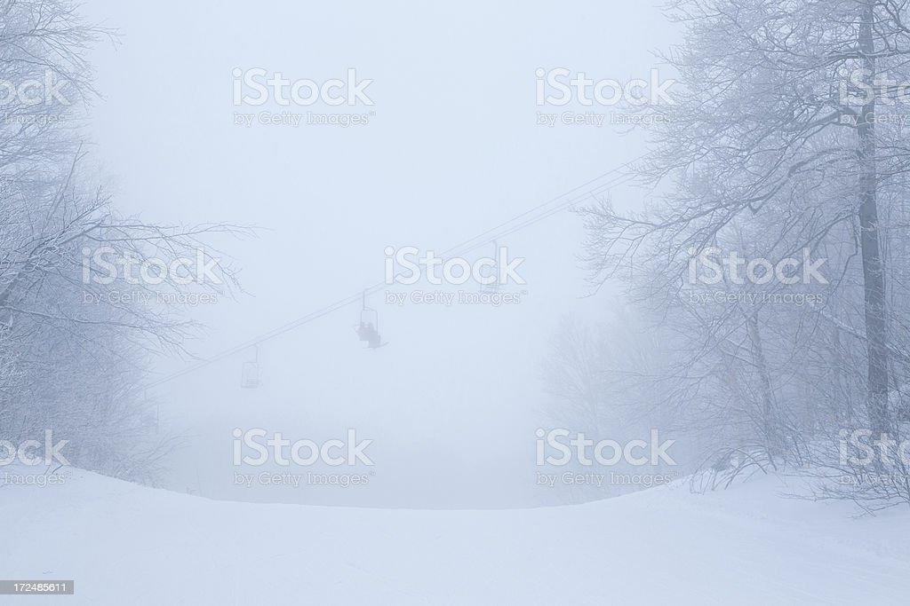 Chairlift in the clouds royalty-free stock photo