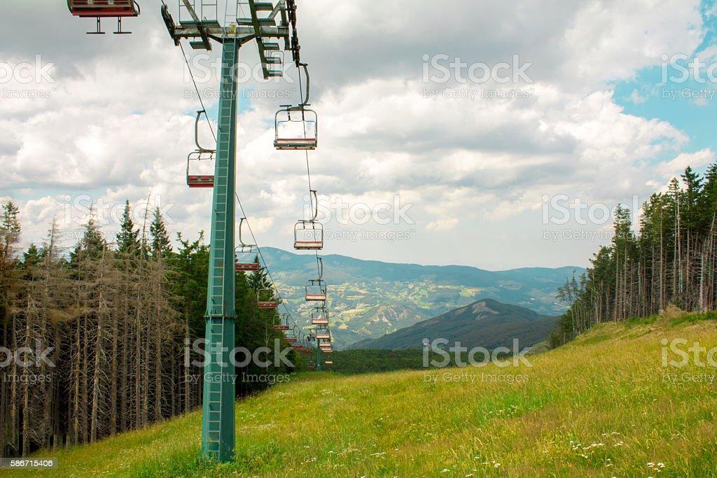 Chairlift ski lift in European Alps. stock photo