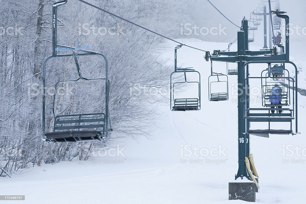 Chairlift to the clouds royalty-free stock photo