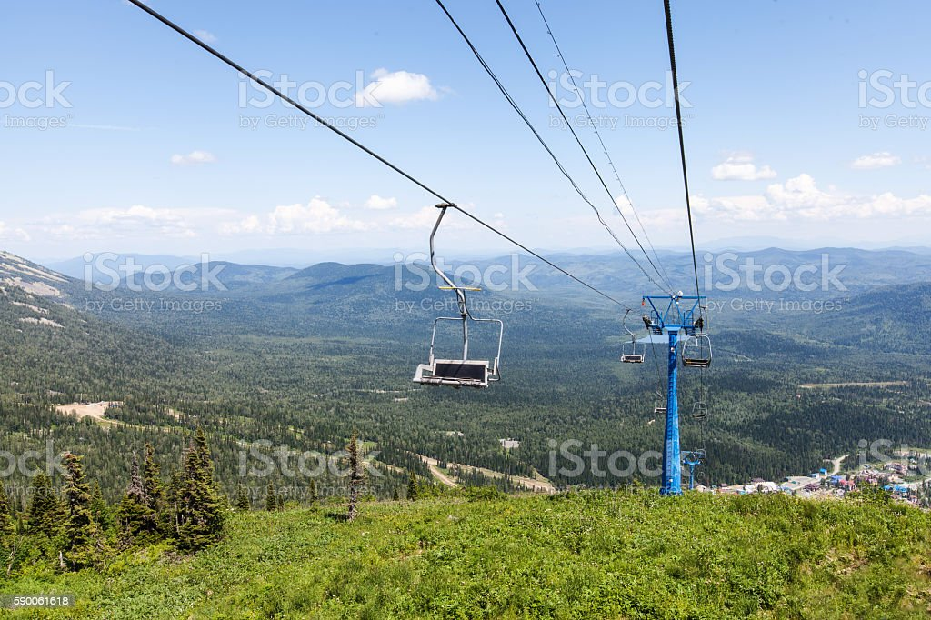 Chairlift, view from high mountain, summer landscape stock photo