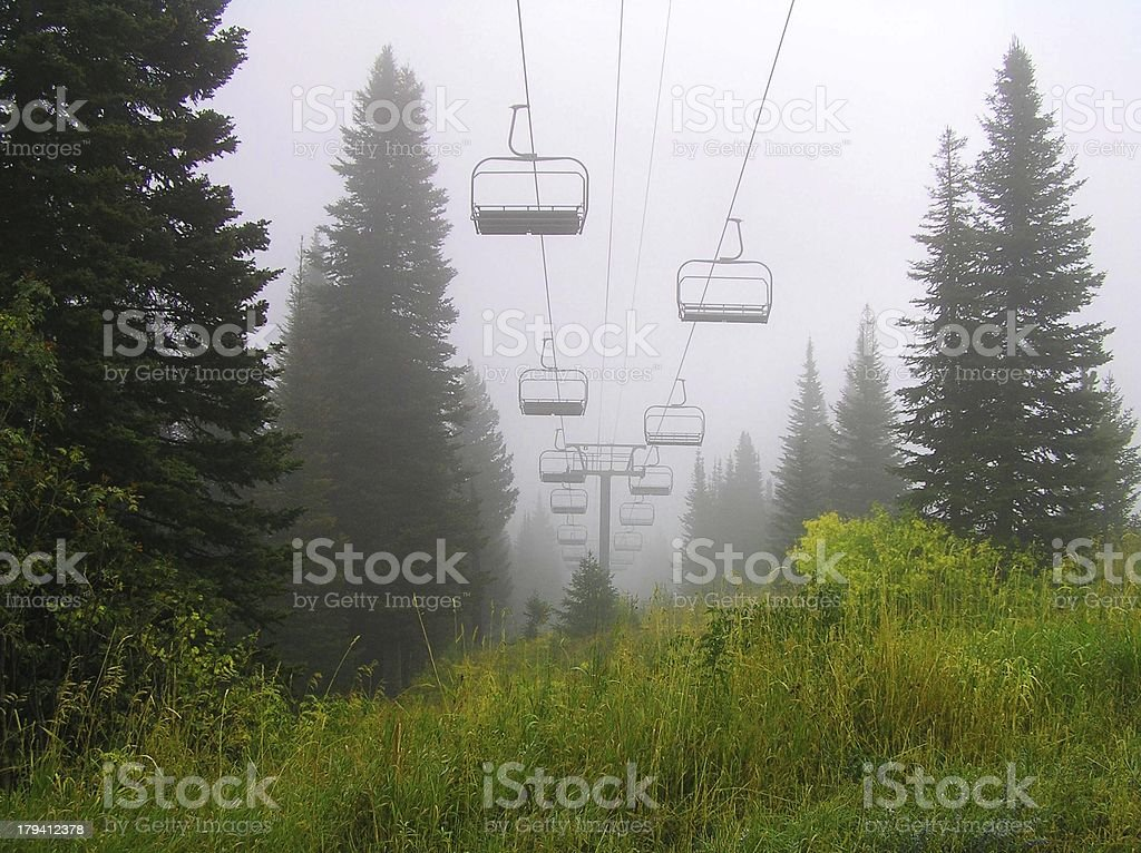 Chairlifts in Fog stock photo