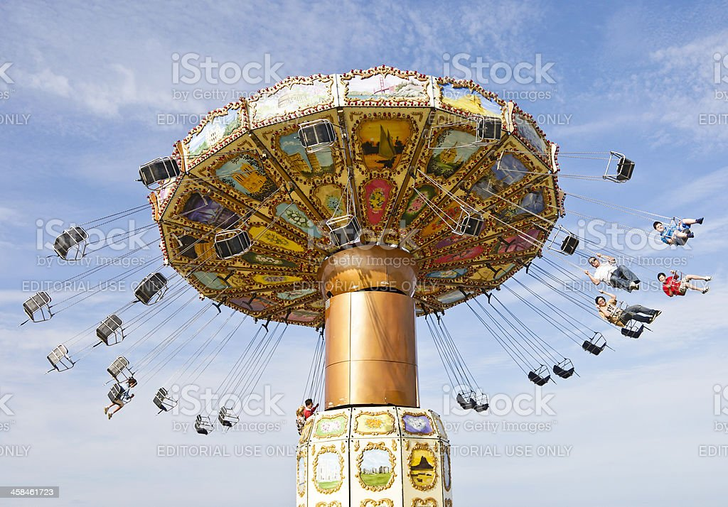 Chairoplane fairground ride, against sky stock photo