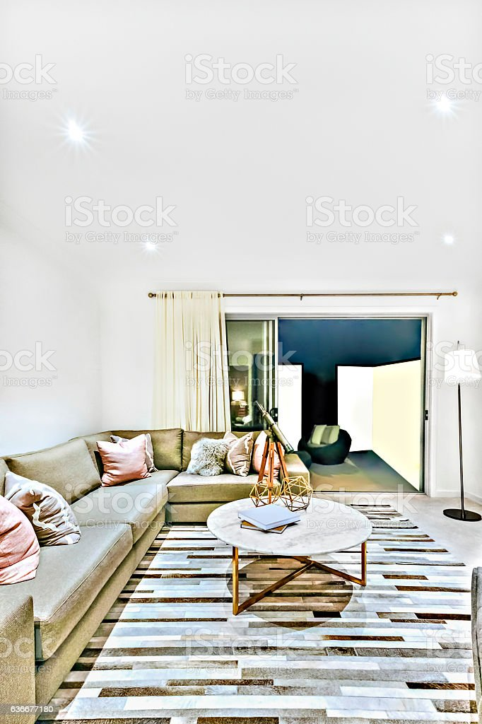 Chairs and a table on the floor carpet at night stock photo