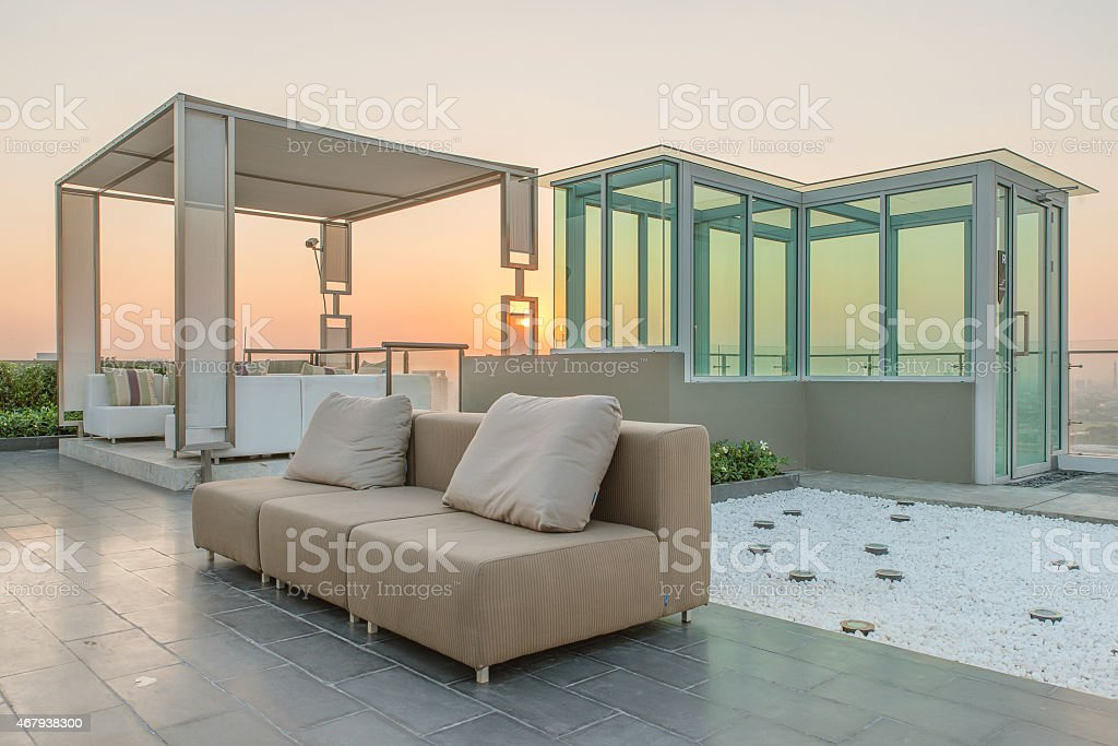 Chairs and couch provide a place from highrise rooftop stock photo