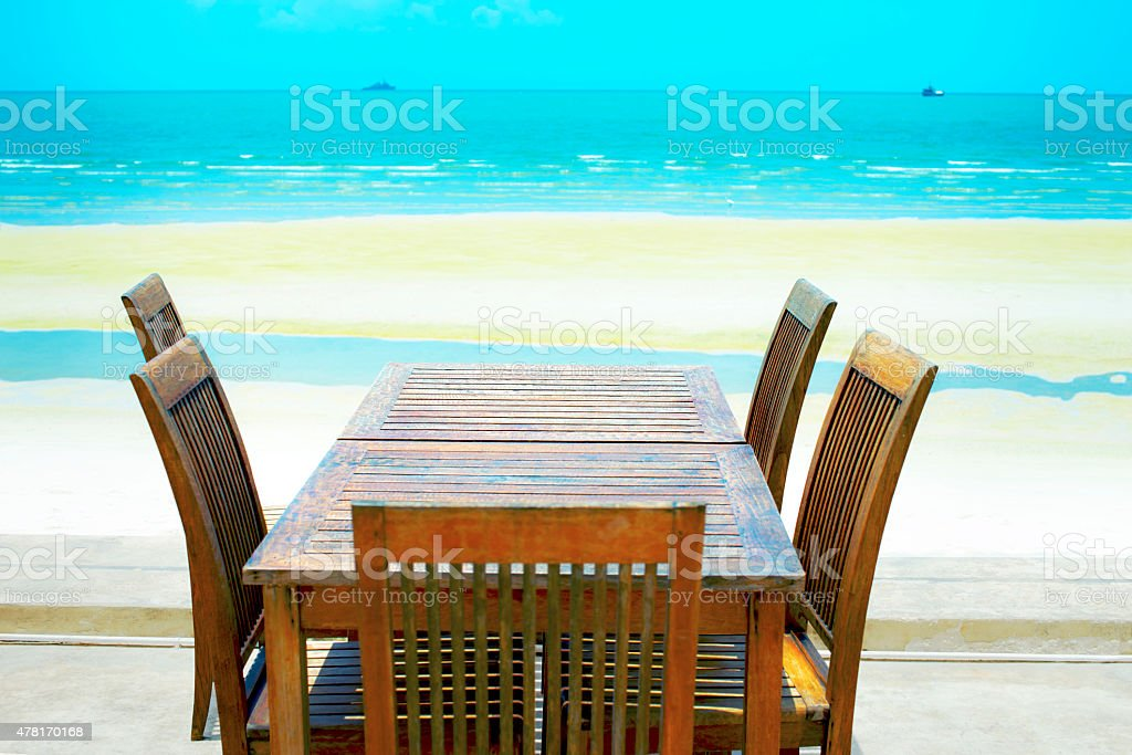 Chairs and desk near by the beach royalty-free stock photo