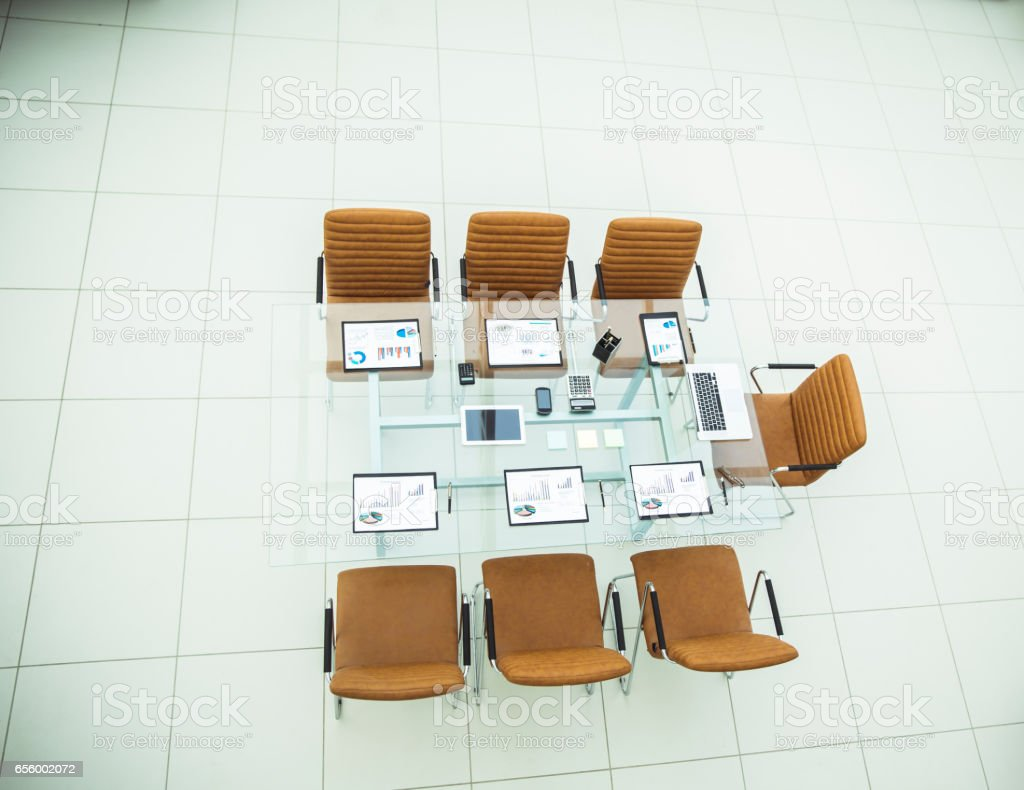 chairs and Desk with documents and laptop for negotiations with business partners stock photo