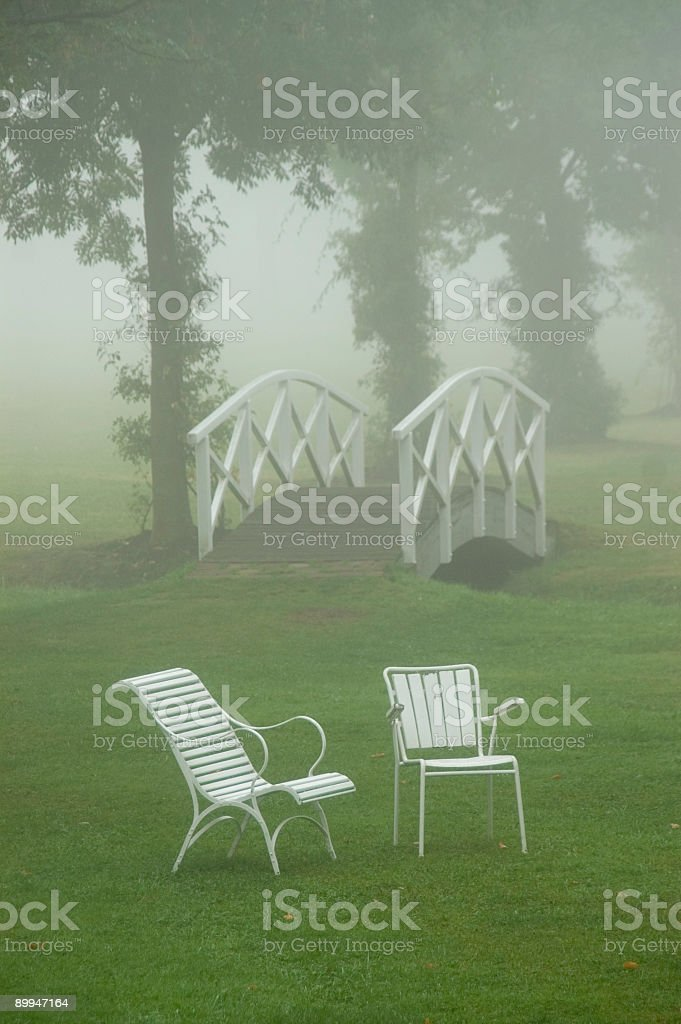 Chairs and footbridge royalty-free stock photo