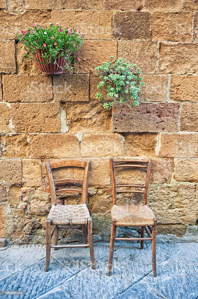 Chairs And Pots of Flowers In Pienza, Tuscany royalty-free stock photo