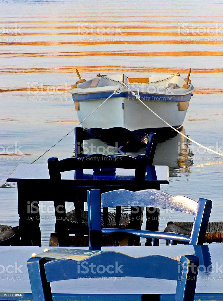 Chairs and table by the sea, Serifos, Greece stock photo