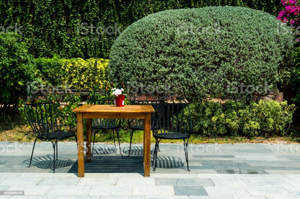 Chairs and table in garden. stock photo