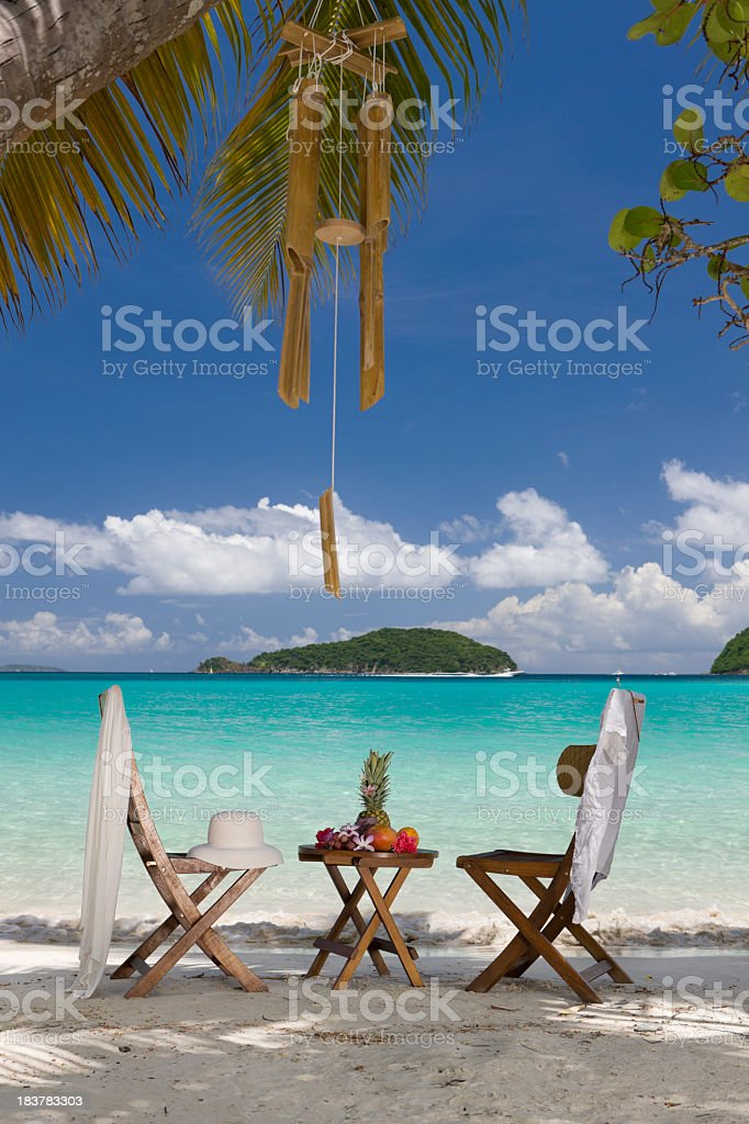 chairs and table with exotic fruits at a Caribbean beach royalty-free stock photo