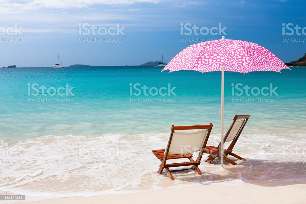 chairs and umbrella at a beach in the Caribbean royalty-free stock photo