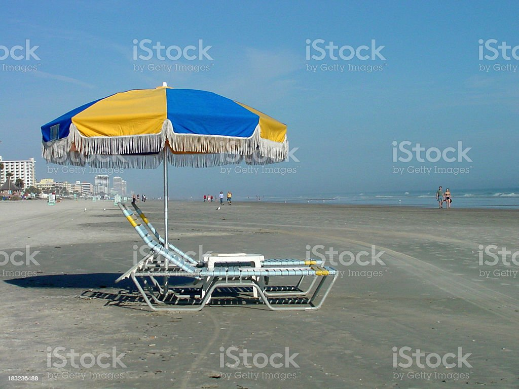 Chairs and Umbrella on the Beach royalty-free stock photo