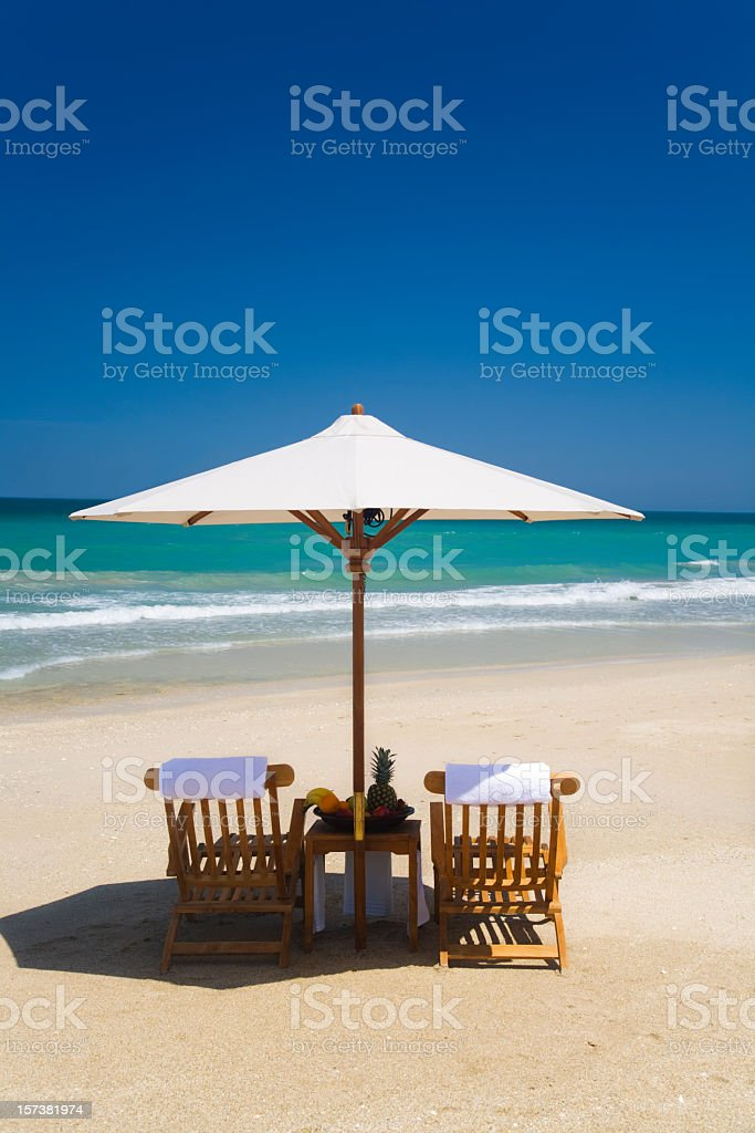 chairs and umbrella with fruit royalty-free stock photo