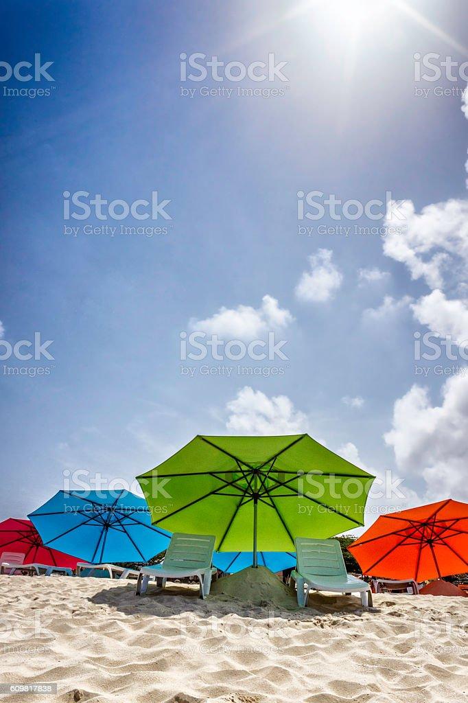 Chairs and umbrellas at Aruba island white sand beach stock photo