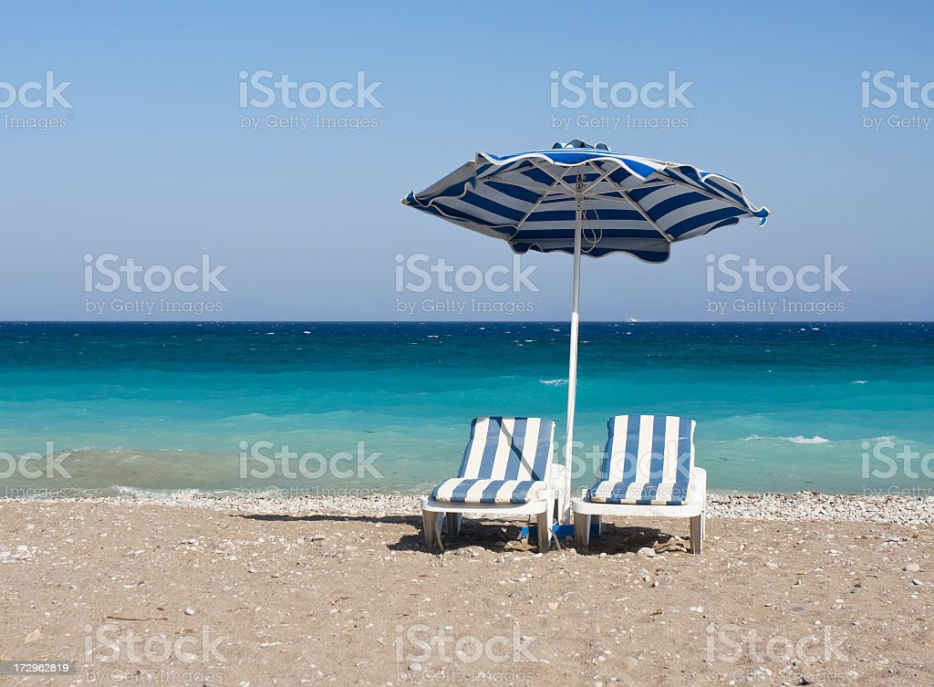 Chairs and umbrellas on beautiful beach. royalty-free stock photo