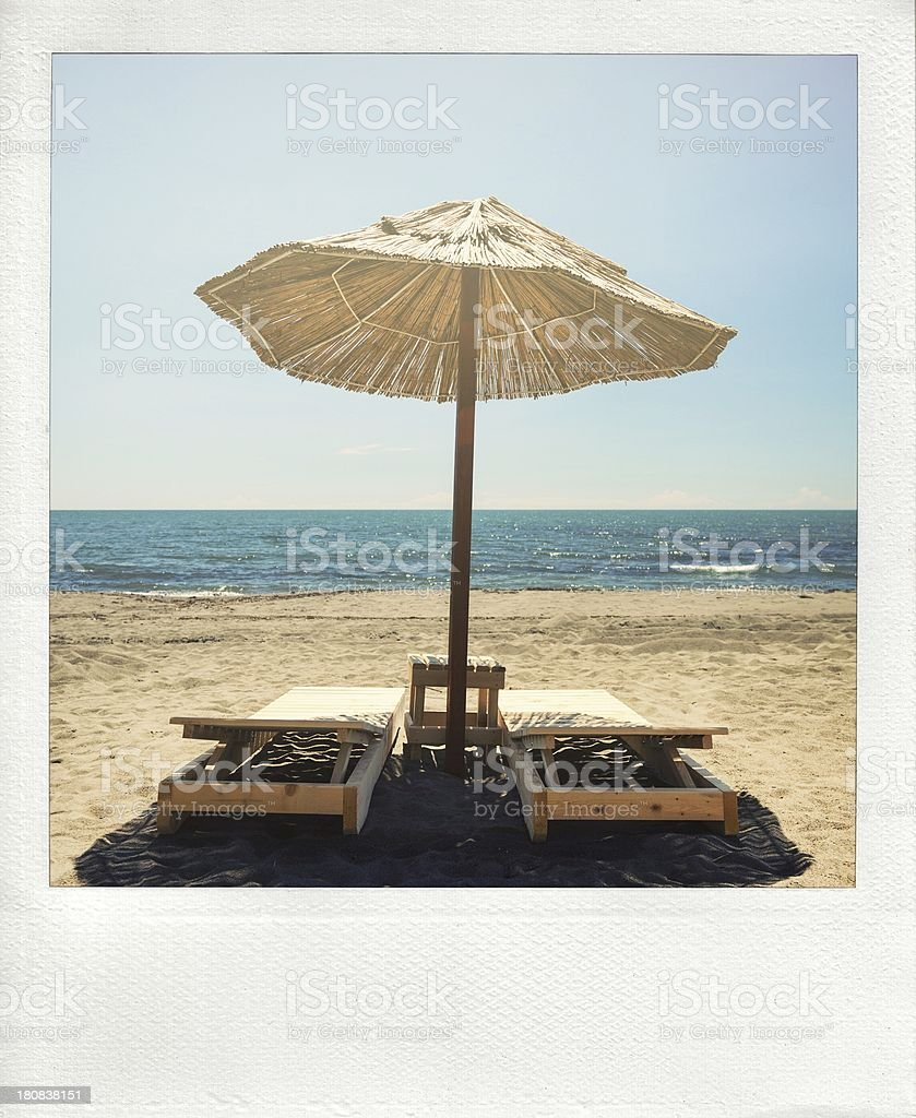 Chairs and umbrellas on sand beach royalty-free stock photo