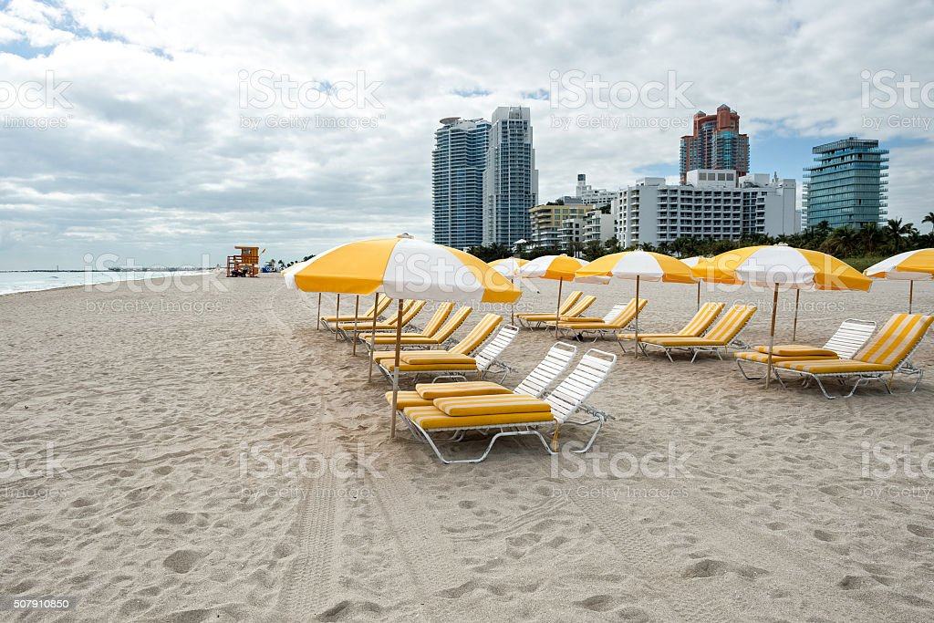 Chairs and umbrellas on the beach stock photo