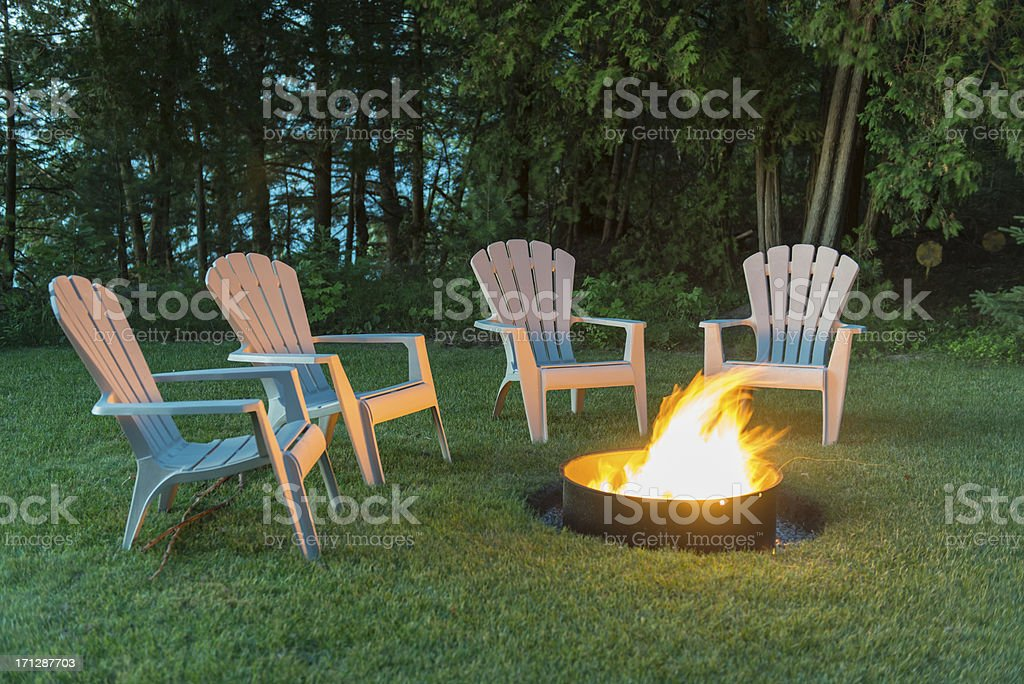 Chairs around a camp fire stock photo