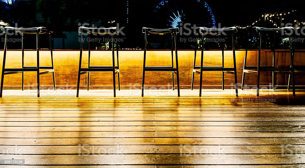 Chairs at a rack in an empty bar stock photo