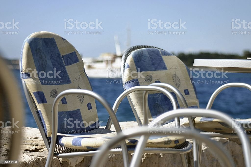 Chairs at coastline royalty-free stock photo