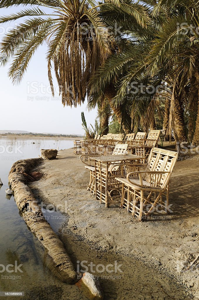 Chairs by a desert lake stock photo