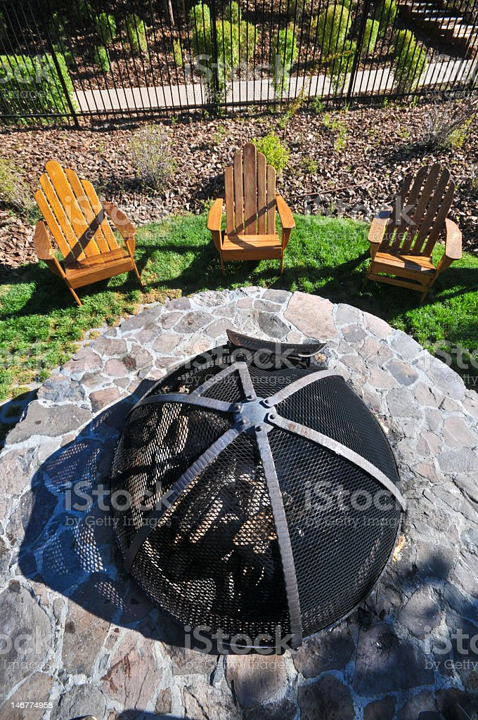 Chairs by a fire pit from above royalty-free stock photo