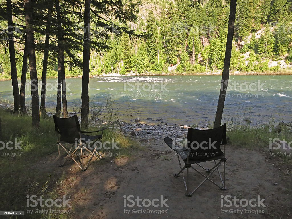 Chairs by a River stock photo