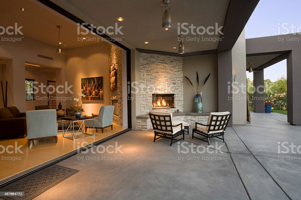 Chairs By Fireplace In Patio stock photo