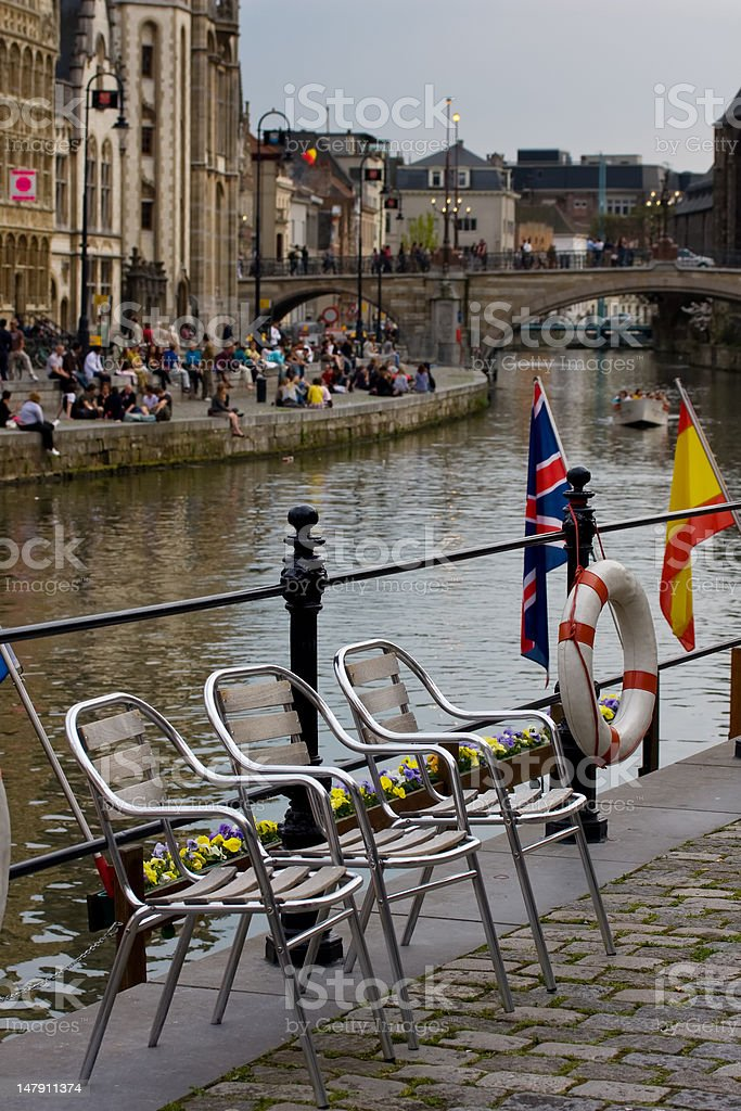 Chairs by Graslei (River Leie) royalty-free stock photo