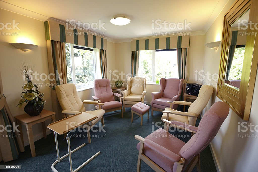 Chairs facing each other in the Care home living room royalty-free stock photo