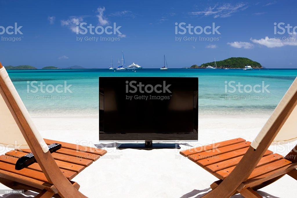 chairs in a front of TV at the Caribbean beach royalty-free stock photo