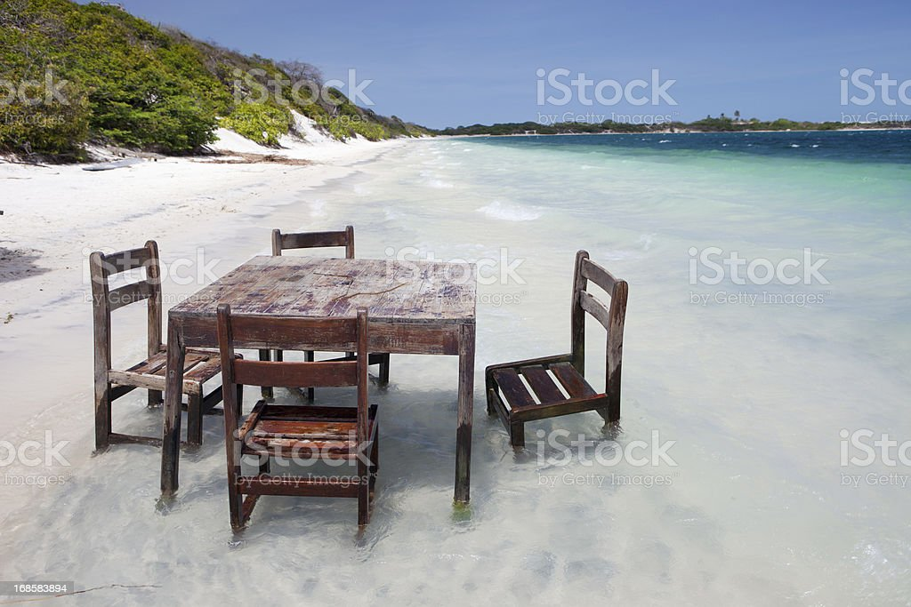 Chairs in a Lagoon of Jericoacoara, Brazil stock photo