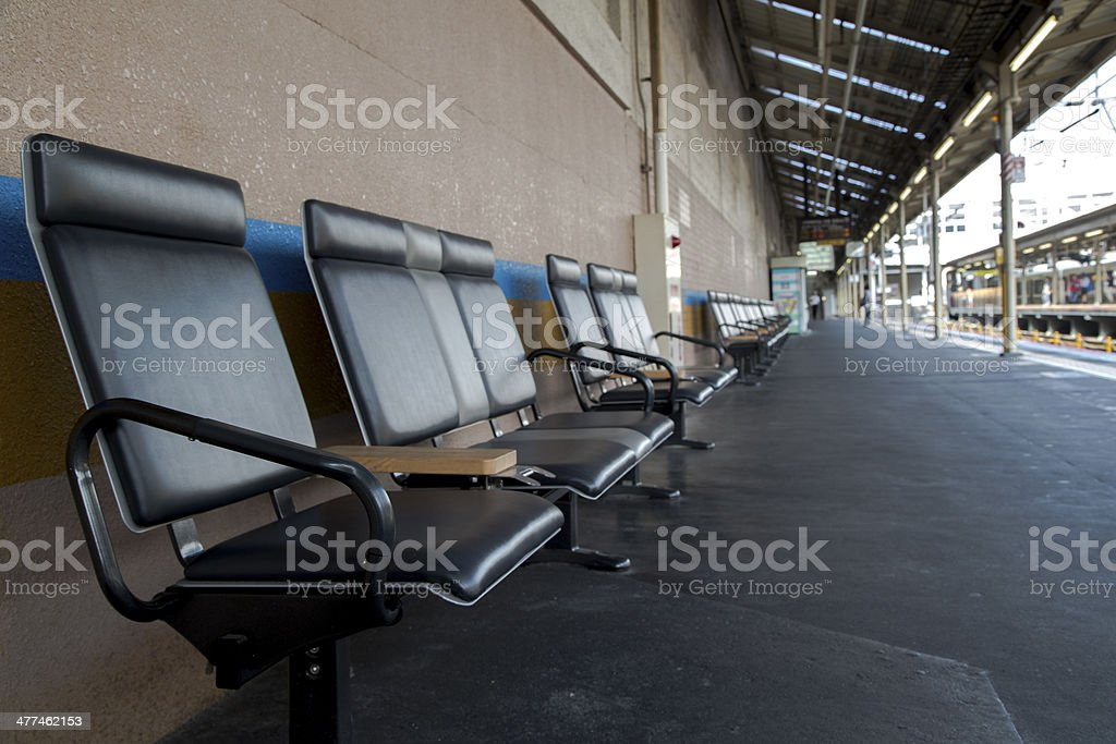 chairs in a railway station stock photo