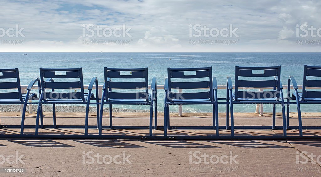 Chairs in front of the sea royalty-free stock photo