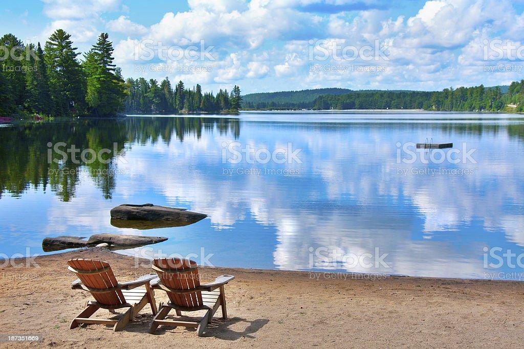 chairs lake shore stock photo