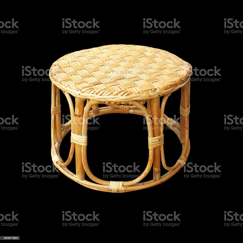 Chairs made of woven rattan on black background stock photo